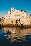 Sea view of Cascais city in Portugal at sunrise with fishing boa Royalty Free Stock Photography