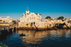 Sea view of Cascais city in Portugal at sunrise with fishing boa. Ts visible Stock Images