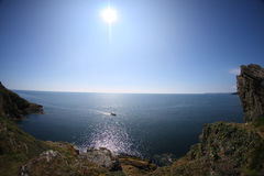 Sea view from cliffs blue sky and sun Stock Photo