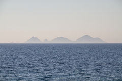 Sea view of a far away island Royalty Free Stock Image
