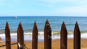 Sea view through the fence, tropical island seascape, summer holiday beach landscape, Royalty Free Stock Photography