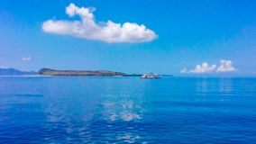 The sea view from the ferry's deck to Sumbawa Island royalty free stock photos