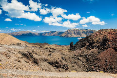 Sea view on the Greek Islands. The volcano near the island of Santorini Royalty Free Stock Photography