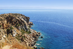 Sea view from high rocky cliff. Very nice sea view from a high rocky cliff in southern Greece Royalty Free Stock Image
