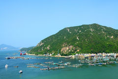 Sea view in Hong Kong from hill top. It is taken in Lamma Island, Hong Kong. The photo has many boats showing the fishing village background of HK Royalty Free Stock Photo