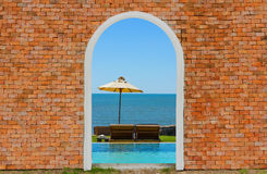 Sea view inside on the brick wall. Concept stock photos