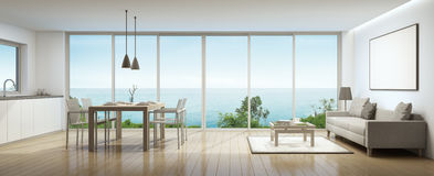 Sea view interior. Living room, dining room and kitchen in luxury house with white picture frame- 3D rendering Royalty Free Stock Photography