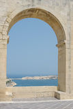 Sea view through a large arch Stock Images
