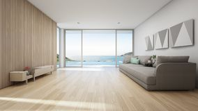 Sea view living room of luxury summer beach house with swimming pool and wooden terrace. TV stand against big gray sofa in vacation home or holiday villa. Hotel royalty free illustration