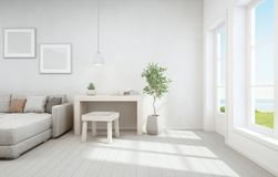 Sea view living room and small working area of modern luxury beach house. Wooden desk with sofa near white window in vacation home. 3D rendering of home interior stock illustration
