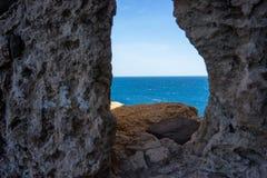 Sea view. Mediterranean sea view through a hole Royalty Free Stock Image