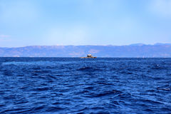Sea view. Mountain view. View on Albania mointains. Beautiful Ionian dark blue sea. Lonely little rock in the middle of the sea Stock Photos