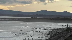 Sea View with mountains in the evening light, Welsh coast stock footage