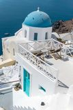 Sea view from Oia Santorini Greece with domes and white houses vertical royalty free stock photos