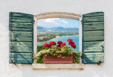 Sea view through the open window with flowers Royalty Free Stock Image