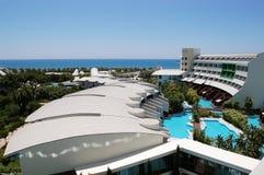 Sea view, original modern buildings and pools in the luxury Turk. Belek, Turkey - June 01, 2015: Sea view, original modern buildings and pools in the luxury Stock Photography