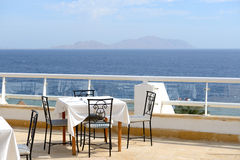 The sea view outdoor terrace of restaurant at luxury hotel Royalty Free Stock Images