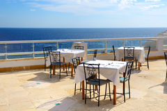 The sea view outdoor terrace of restaurant at luxury hotel Royalty Free Stock Photos