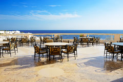 The sea view outdoor terrace of restaurant at luxury hotel Royalty Free Stock Image