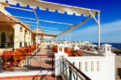 The sea view outdoor terrace of restaurant at luxury hotel Stock Photos
