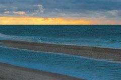 Sea View. The picture shows the sea during sunset before the storm Stock Photo