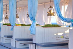 Sea View Restaurant White Terrace With Wooden Furniture And Hang Stock Photo