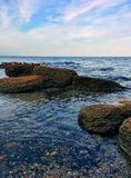 Seascape from rocky coast. Sea view from rocky coast with cloudy sky Stock Images