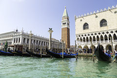 Sea view of San Marco Square with gondolas Palazzo Ducale and Campanile Stock Photo
