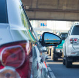 Sea view in side mirror of car with traffic jam Royalty Free Stock Photography