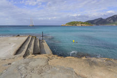Sea view with steps and brig. Sant Elm, Mallorca, Balearic islands, Spain Stock Photo