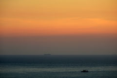 Sea view sunset with mountain Stock Images