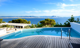 Sea view swimming pool in the luxury hotel Royalty Free Stock Photos