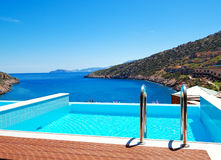 The sea view swimming pool at the luxury villa Stock Photos