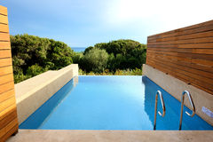 Sea view swimming pool by luxury villa Stock Image