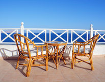 Sea view table and chairs Royalty Free Stock Photos