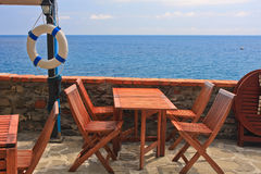 Sea view table with chairs Stock Images