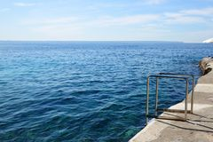 The sea view terrace and beach ladder. Mallorca, Spain Royalty Free Stock Photography