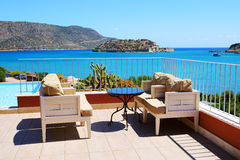 Sea view terrace at luxury hotel with a view on Spinalonga Royalty Free Stock Image