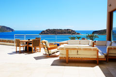 Sea view terrace at luxury hotel with a view on Spinalonga Royalty Free Stock Photo