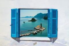 Sea view through traditional greek window Stock Photo