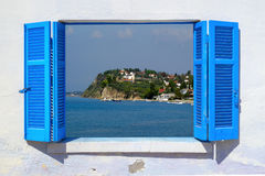 Sea view through traditional greek window Royalty Free Stock Photography
