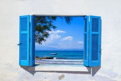 Sea view through traditional greek window Stock Photography