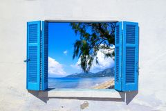 Sea view through traditional greek window Royalty Free Stock Images