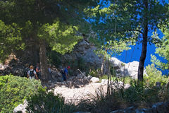Sea view Tramuntana mountains Mallorca. MALLORCA, SPAIN - MAY 15, 2017: People on walking path in landscape in Tramuntana mountains between Soller and Cala Tuent Stock Images