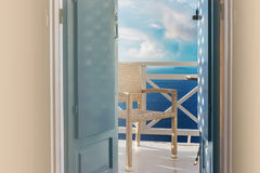 Sea view trough traditional wooden shutters on Santorini island, Oia, Greece. Balcony overlooking from a hotel romantic room. Stock Photos
