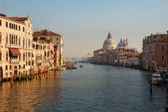 Sea view on Venice grand channel at the morning with historical architecture and on basilica della salute at the horizon in Italy Stock Photography