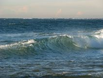 Sea view with wave. Breaking in the foreground royalty free stock images