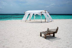 Sea view with a wedding tent. Sea view on tropical beach with a wood seat and wedding tent Stock Images