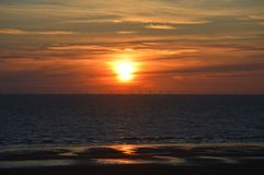 A sea view of a windfarm at sunset Royalty Free Stock Images