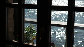 Sea view from the window of a cafe. Sea view from the window of a cafe in Montenegro stock video footage